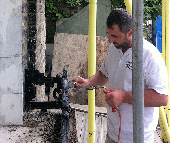 Stripping old paint from exterior ironwork